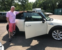 Stewart has chosen to have fun in this 2011 MINI Cooper S Convertible in Pepper White with Black Hood