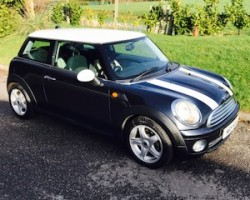 Darren & his beautiful family chose this 2006 MINI Cooper with Chili Pack with Half White Leather & Just Serviced