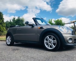 Coral chose this 2012 MINI Cooper Convertible in Velvet Silver with Chili Pack & Huge Spec