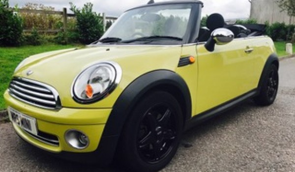 Andrew & Fiona have chosen this 2009 MINI Cooper Convertible with Chili Pack in Interchange Yellow with Heated Sports Seats & LOW MILES