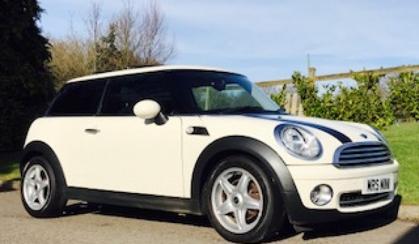 Helen & John have chosen this 2010 MINI Cooper Chili AUTOMATIC with SUNROOF & Half Red Leather Sports Seats