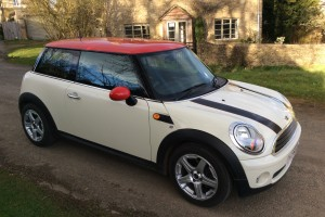 2009 MINI One 1.4 in Pepper White with Red Roof & Mirror Caps
