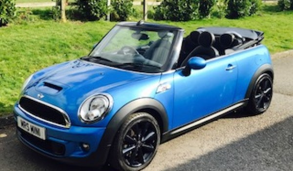 Joy has chosen this 2011 Mini Cooper S Convertible in Lazer Blue with Huge Spec