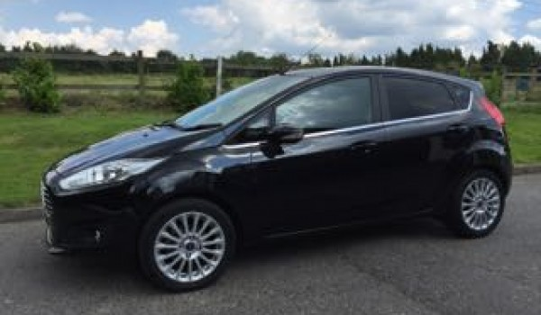 sally has chosen this 2013 ford fiesta titanium in black. Black Bedroom Furniture Sets. Home Design Ideas