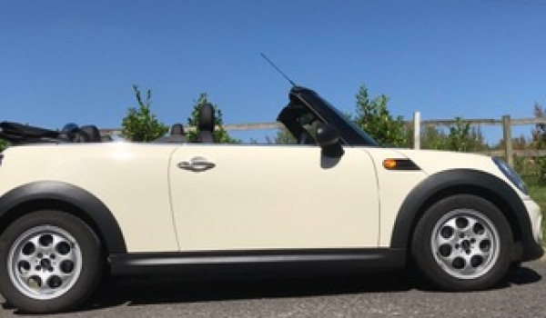 An Anniversary present for a lucky wife – 2011 MINI One (Salt Pack) Convertible in Pepper White with Ridiculously Low Miles 12K!