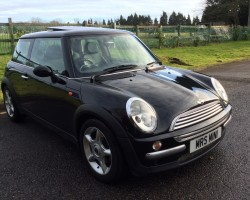 Giles has chosen this for his lovely wife – 2004 BLACK MINI COOPER AUTOMATIC 1.6 with SAT NAV PANORAMIC SUNROOF & LEATHER