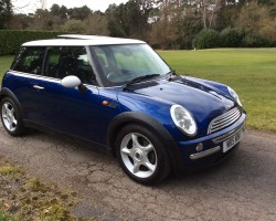 Christina is having this 2003 / 53 MINI Cooper in Blue with Chili Pack and Panoramic Glass Sunroof