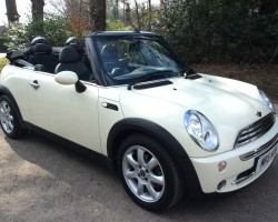 Charlie has taken this 2008 MINI Cooper Convertible in Pepper White with Chili Pack & Low Miles