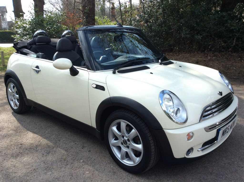 charlie has taken this 2008 mini cooper convertible in pepper white with chili pack low miles. Black Bedroom Furniture Sets. Home Design Ideas