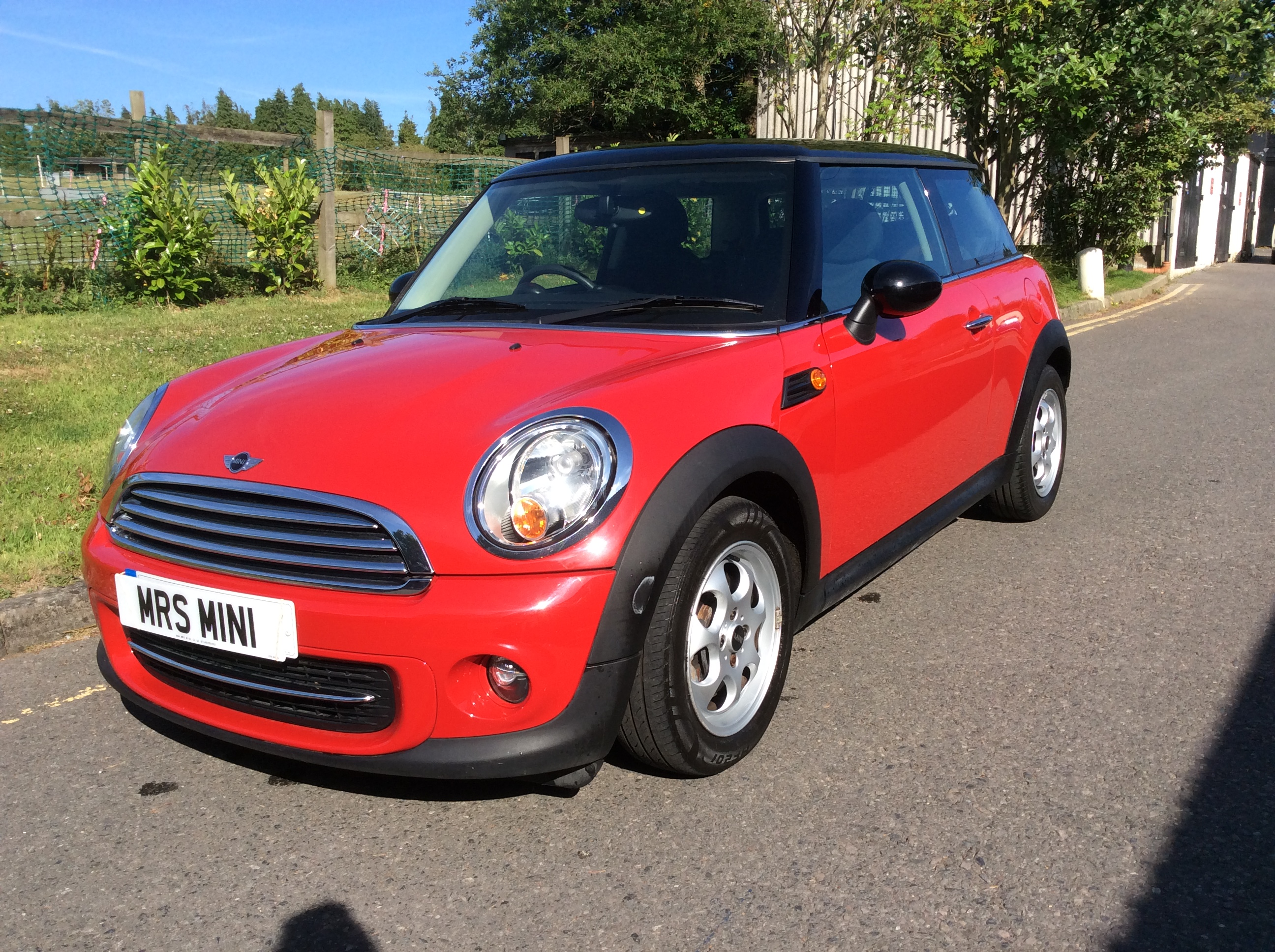 the very pretty angela helped mum and dad choose this 2011 mini cooper in chili red automatic. Black Bedroom Furniture Sets. Home Design Ideas