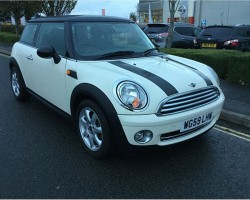 Charlene has chosen this 2009 / 59 MINI Cooper In Pepper White with Chili Pack & Ridiculously LOW MILES