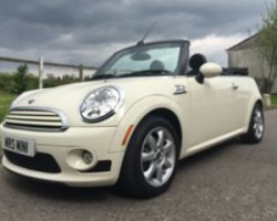 Kerry is having this 2009 / 59 MINI Cooper Convertible Chili & Visibility Packs with Sports Bodykit In Pepper White with Lounge Leather