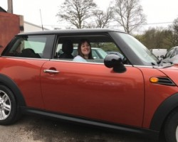 Diane has chosen this 2010 MINI Cooper Spice Orange With Chili Pack & Ridiculously Low Miles 20K