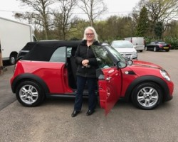 Alex has chosen this 2013 MINI One Convertible Chili Red with Ridiculously Low Miles 10K!