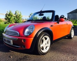 Heidi chose this 2006 MINI Cooper Convertible in Hot Orange with FULL SERVICE HISTORY