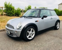Ben has chosen this 2005 MINI Cooper in Pure Silver with Chili Pack & just 56K miles plus a Panoramic Glass Sunroof