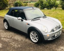 Howard and Beverley chose this 2007 / 57 MINI Cooper Convertible in Pure Silver with Blue Hood & Full Leather Heated Sports Seats