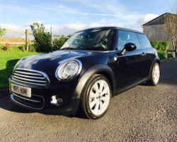 Zoe has chosen this 2010 / 60 MINI Cooper In Black with Chili Pack, Full History & FULL CREAM LEATHER INTERIOR
