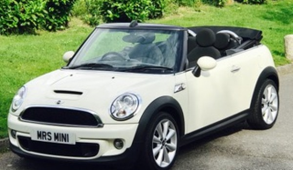 Sarah chose her this time around – 2011 MINI Cooper S Convertible in Pepper White with Black Hood