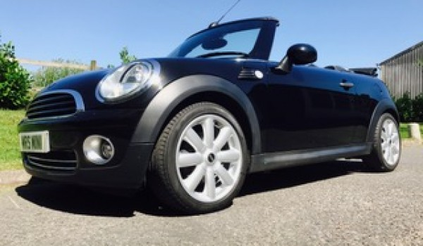Judy and her family choose this 2010 MINI Cooper Automatic with Chili Pack in Black with High Spec