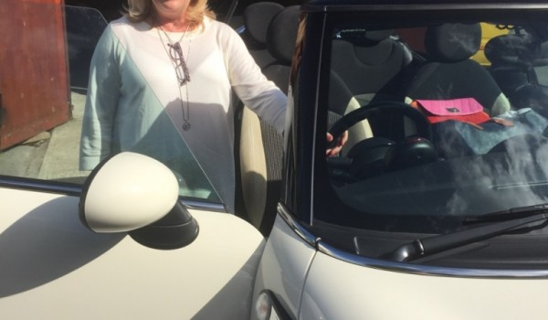 The very glamorous Irene chose this 2009 MINI Cooper Convertible in Pepper White with low miles 35K & Half White Leather Interior