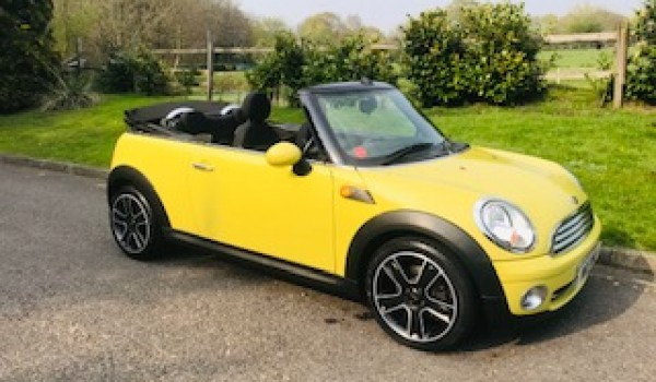 Sharron & Nigel chose this 2009 / 59 MINI Cooper Convertible in Interchange Yellow with Service History & Low Miles