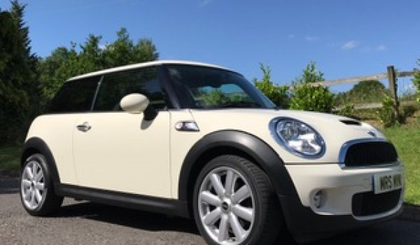 Mike chose this 2009 / 59 MINI Cooper S with Chili & Visibility Packs in Pepper White with Low Miles 26K & 1 Owner